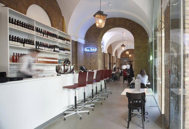 The Gallery Mess is housed in the old Duke of York's officers' mess where exposed brickwork emerges from white-painted ceilings and arches, while neon installations add a touch of sophistication