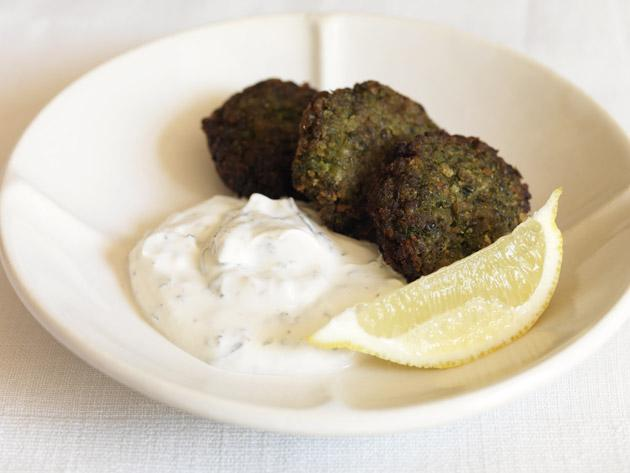 Fresh pea falafels can be served hot with the lemon wedges or cold for a picnic