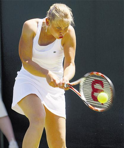 Jelena Dokic was treated by the trainer for dizziness during her defeat to Tatjana Malek yesterday