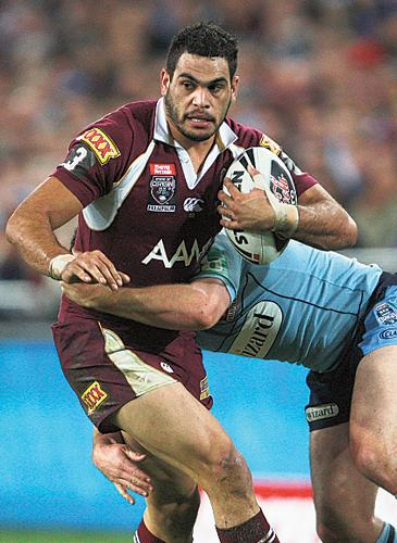 Queensland's Greg Inglis runs at New South Wales in Sydney