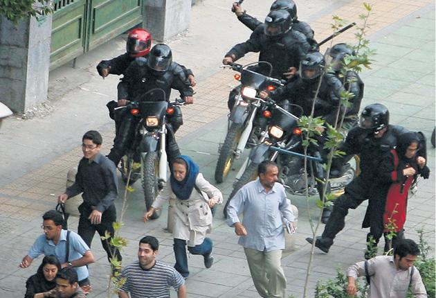 Supporters of Mirhossein Mousavi are pursued by riot police earlier this month. Amnesty International has voiced fears that some of those arrested risked being tortured while in custody