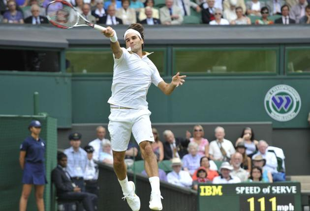 Roger Federer stretches for the ball on Centre Court yesterday