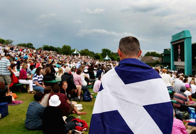 A Scot is wrapped up in patriotic fervour watching play from Murray Mount on Saturday