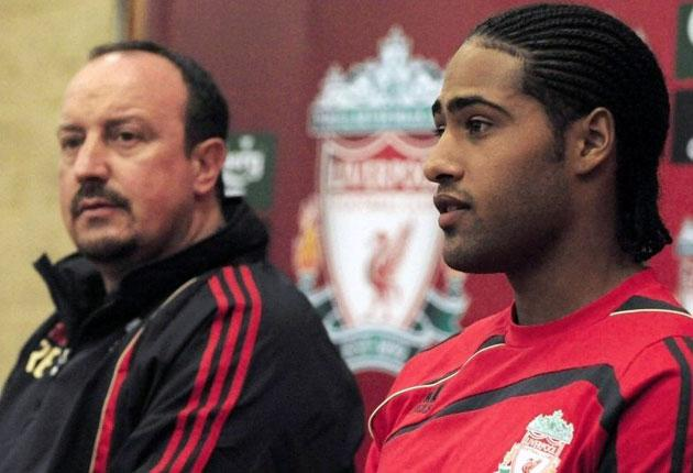 Rafael Benitez presents the £18.5m full-back Glen Johnson as a Liverpool player at Anfield yesterday