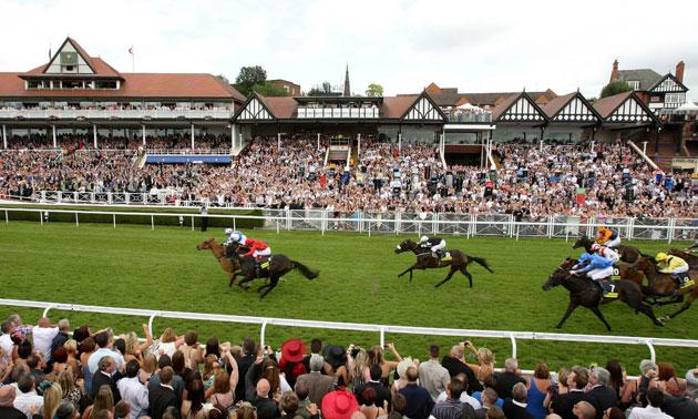 Adrian Nicholls guides Regal Parade to victory in the City Plate from Balthazaar's Gift (red silks) at Chester
