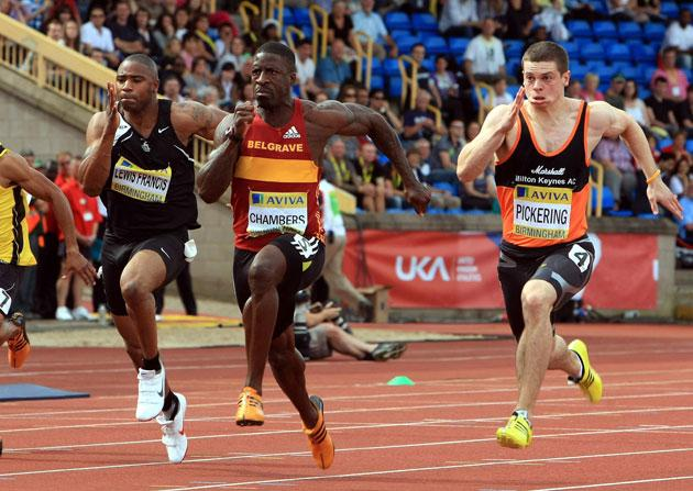 Dwayne Chambers (centre) leads Craig Pickering and Mark Lewis Francis during the 100m semifinal in Birmingham