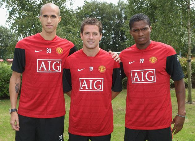 Michael Owen, Gabriel Obertan and Luis Antonio Valencia of Manchester United pose at the press conference to unveil the club's new signings at Carrington Training Ground