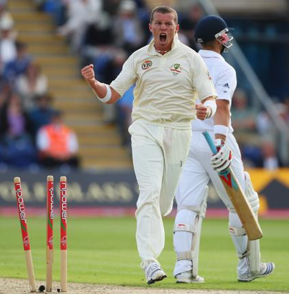 Peter Siddle, pictured after bowling Matt Prior in Cardiff, says that he is at his best when he is 'fired up'