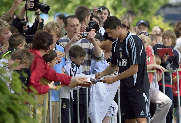 Real Madrid's Cristiano Ronaldo signs autographs after a training session in Carton House Hotel in Maynooth
