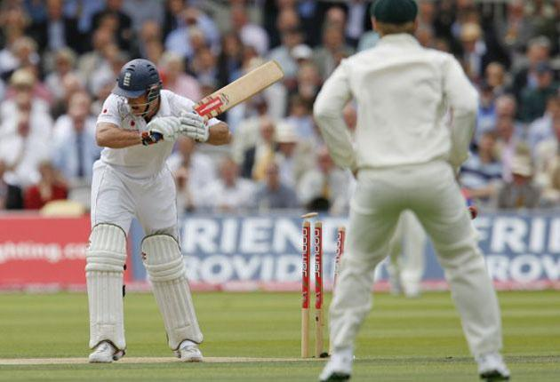 England's Captain Andrew Strauss is bowled by Australia's Ben Hilfenhaus