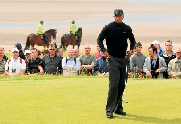 Tiger Woods shows his frustration during the second round of the Open yesterday