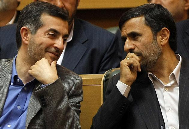 According to a senior cleric, Mahmoud Ahmadinejad, right, showed a 'twisted face' to the religious elite by appointing Esfandiar Rahim Mashaie, left