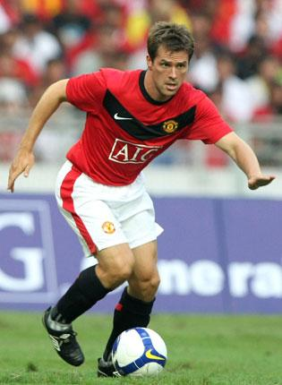 Michael Owen made an immediate impact on his Manchester United teammates by scoring in the win over a Malaysia XI