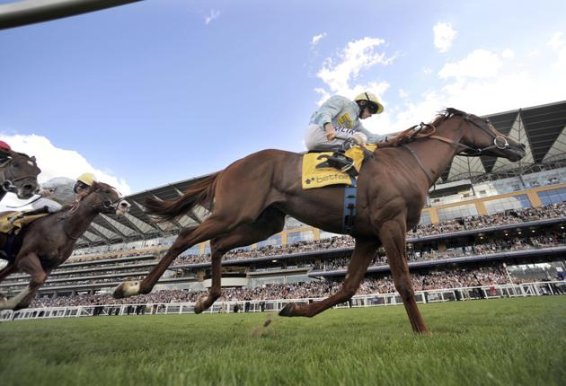Channelled energy: Conduit, ridden by Ryan Moore, surges home in the King George VI and Queen Elizabeth Stakes