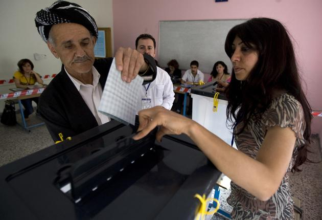 A Kurdish man casts his ballot in Sulaymaniyah, 260 kilometres north-east of Baghdad, yesterday as the region's political elite face their first major challenge since the fall of Saddam