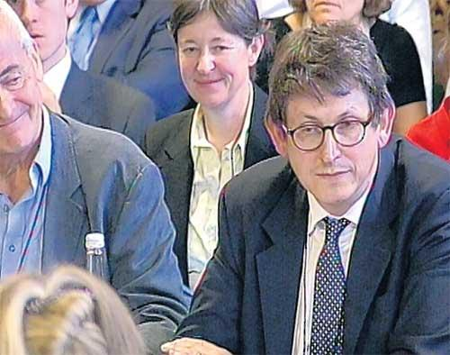 'The Guardian' editor Alan Rusbridger, right, gives evidence to a committee of MPs as Nick Davies, left, looks on
