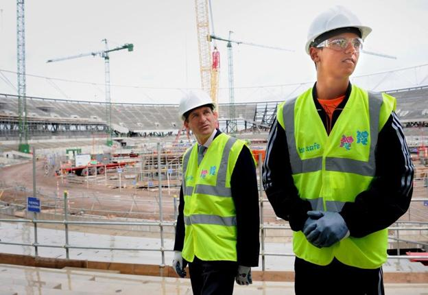 Britain's new diving world champion Tom Daley (right) views the construction of the Olympic stadium in east London along with London 2012 chairman Lord Coe yesterday