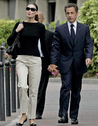 President Sarkozy yesterday with his wife Carla Bruni at the Val-de-Grace hospital