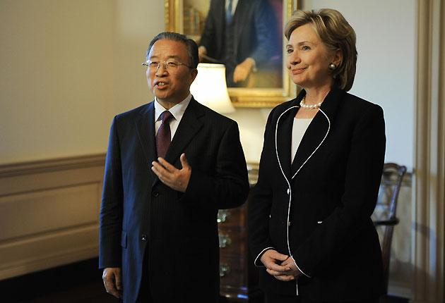 US Secretary Hillary Clinton listens to Chinese State Councilor Dai Bingguo speak to the press during a break in the Strategic Track Discussions of the US-China Strategic and Economic Dialogue at the State Department in Washington