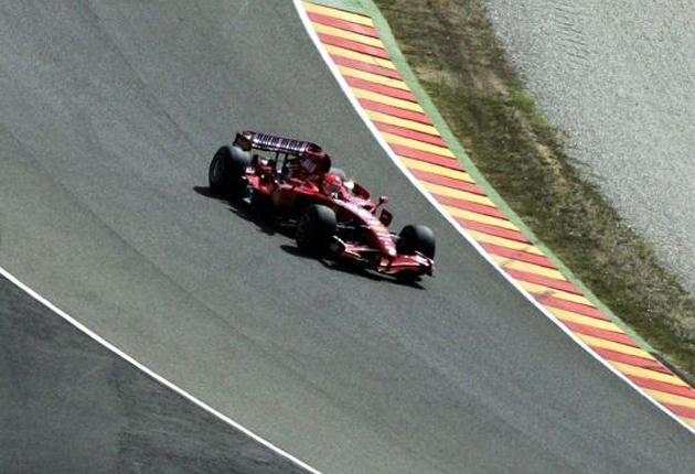 Michael Schumacher takes Kimi Raikkonen's 2007 World Championship-winning Ferrari for a spin at the Mugello circuit in Italy yesterday