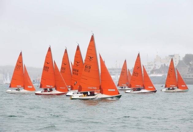 The Squib class sets off, Cowes shrouded in mist, on its opening race of Cowes Week