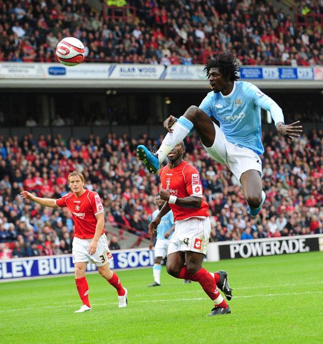City new boy Emmanuel Adebayor goes close at Oakwell yesterday