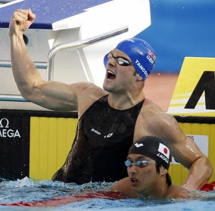 Liam Tancock celebrates winning the gold medal in the 50m backstroke at the world championships yesterday in a world-record time