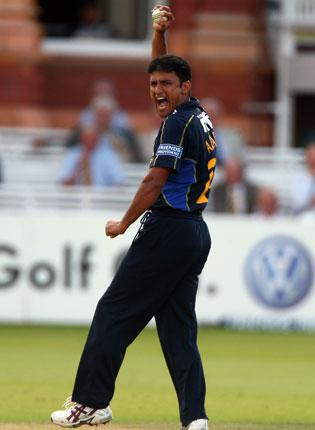 Yasir Arafat, the Pakistan all-rounder, took a hat-trick for Sussex Sharks against Gloucestershire at Horsham yesterday