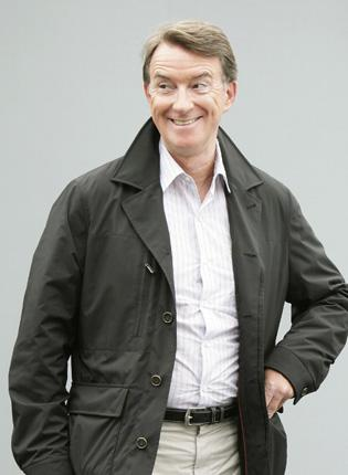 Lord Mandelson arrives back in the UK after his holiday in Corfu to continue deputising for Gordon Brown