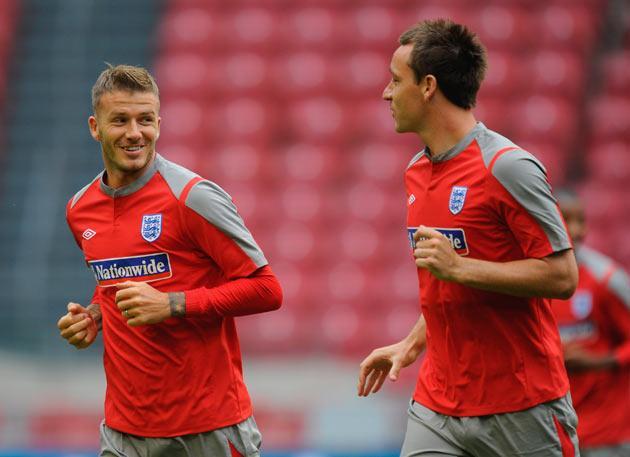 John Terry trains with David Beckham yesterday
