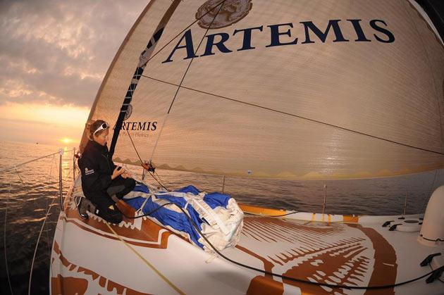Sam Davies in maintenance mode at sunset on Artemis in the Rolex Fastnet Race