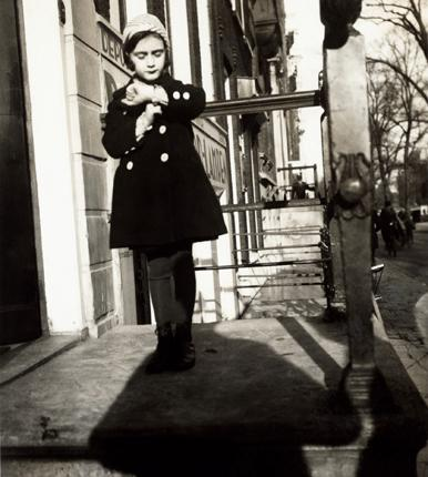 Anne Frank poses in front of Opekta, her father's company in Amsterdam in 1935.