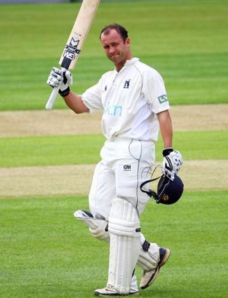 Jonathan Trott celebrates scoring a century for Warwickshire last month