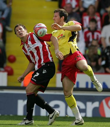Earning his stripes: the Sheffield United striker Darius Henderson (left) battles for the ball with Watford's Mike Williamson