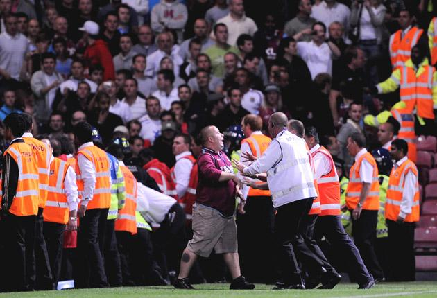 A West Ham United fan confronts the stewards during the Carling Cup tie with Millwall