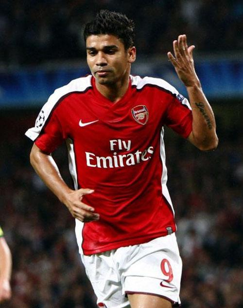 Arsenal's Eduardo celebrates scoring from his controversial penalty against Celtic