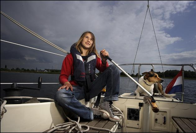 Thirteen-year-old Laura Dekker on the deck of her sailing boat Guppy