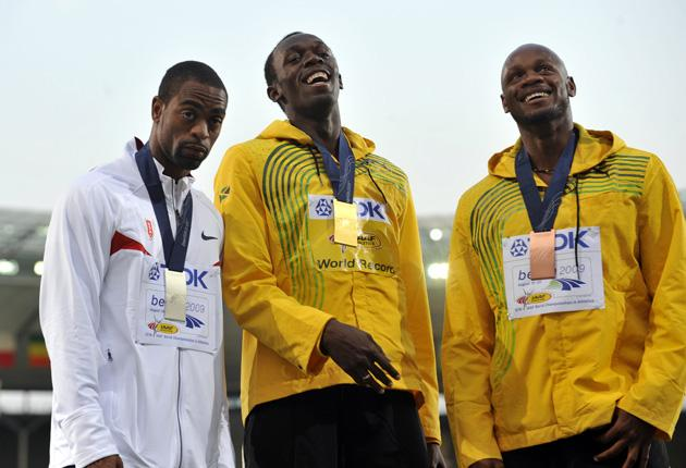 Gay, above left with Bolt and Powell in Berlin: 'My groin's a tad sore but I'll do my best to beat the mark as I'm still trying to run fast'