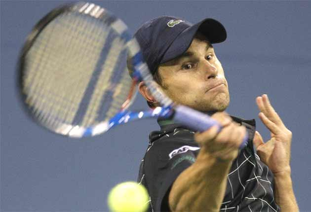 Andy Roddick hits a shot during his late-night, straight-sets victory over Björn Phau on Monday