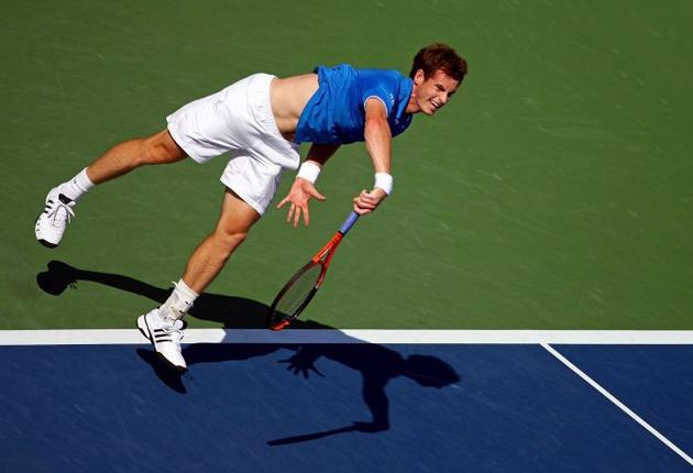 Andy Murray serves at full tilt during his 6-2, 3-6, 6-0, 6-2 victory over the Chilean Paul Capdeville