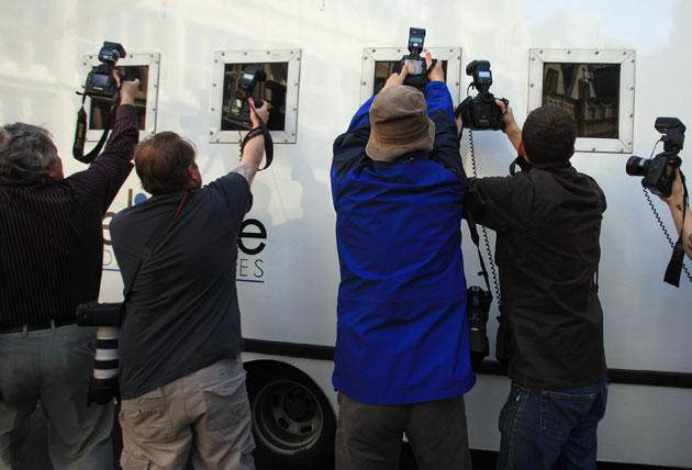 Photographers try to snap an accused child pornographer in Bristol