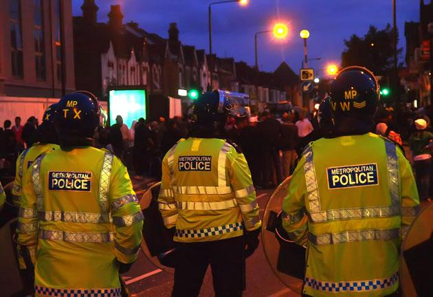 Police outside the Harrow Central Mosque during Friday's clashes between pro- and anti-Islamic groups