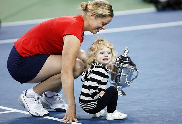 Kim Clijsters of Belgium and daughter Jada pose with the trophy after she defeated Caroline Wozniacki of Denmark in the women's singles final match at the 2009 US Open tennis tournament in New York
