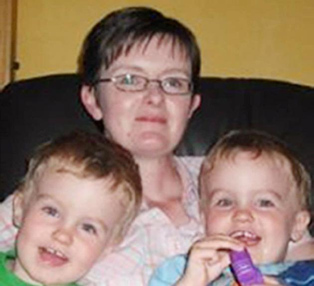 Tracy Mock with her twin sons Aaron and Todd who are on kidney dialysis in St Thomas's Hospital in London, after being infected with E. coli on a visit to Godstone Farm. It is feared that tens of thousands of other people may also have been exposed to the