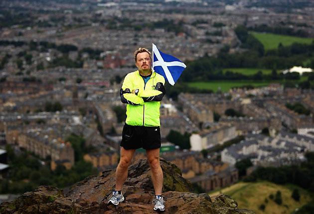 Eddie Izzard atop Arthur's seat in Edinburgh on 27 August 2009. Today he is due to finish his hyper-marathon in Trafalgar Square