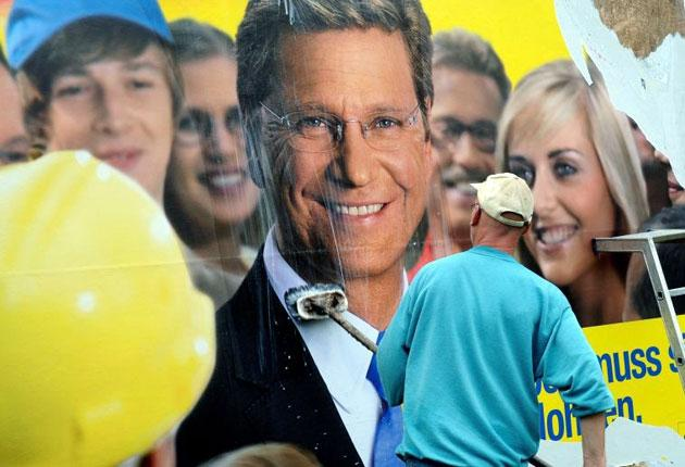 Guido Westerwelle beams from an election poster in Hanover
