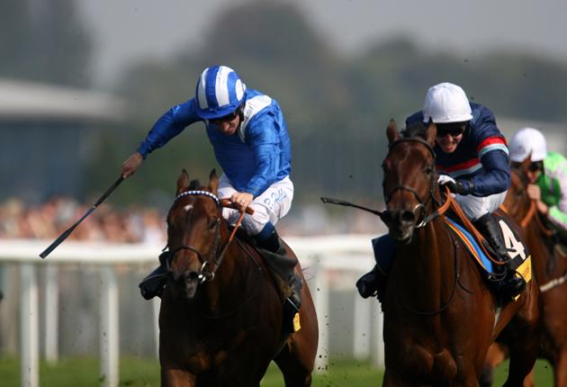 Nursery is child's play Marcus Cicero, ridden by Jim Crowley (white cap), holds off Haadeeth (Richard Hills) to win the Nursery at Newbury