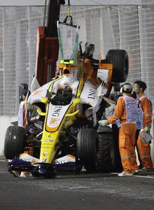 Nelson Piquet's Renault is removed after the deliberate crash in Singapore
