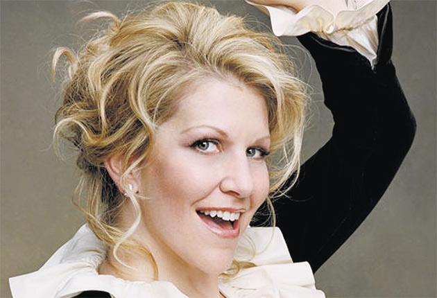 Joyce DiDonato greets me with a gigantic smile, although you might expect the rest of her to belie it: the American diva is confined to a wheelchair with her leg in a bright pink plaster cast.