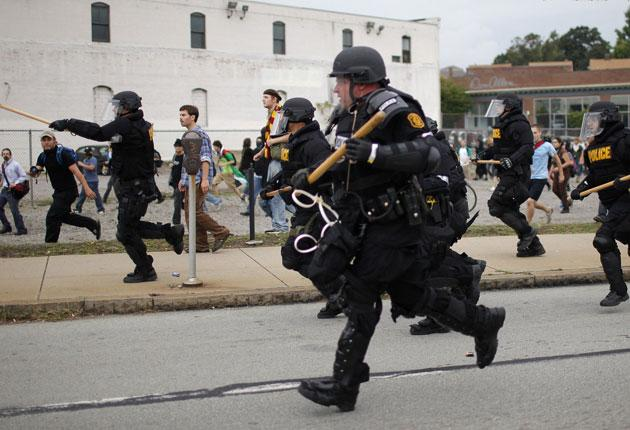 Police in riot gear rush a group of G20 protesters in Pittsburgh yesterday